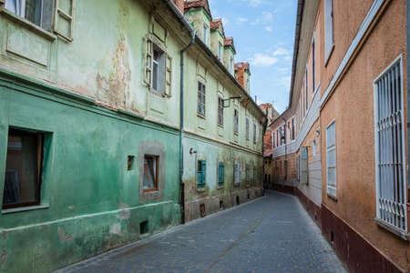 Narrow street in Brasov city in Romania