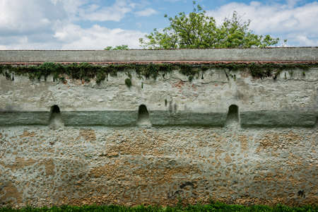 Old forified wall in Brasov city in Romania Stock fotó