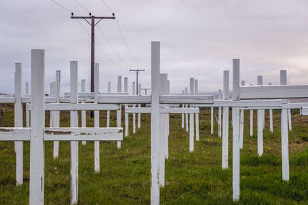 52 crosses for car accidents victimis next to road from Selfoss town to Reykjavik city in Iceland