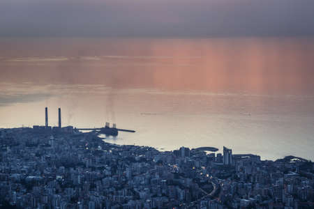 Sunset over Mediterranean Sea coast in Lebanon, view with Zouk Power Plant in Zouk Mikael city