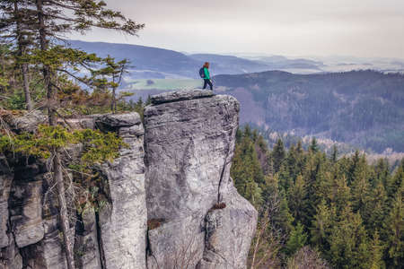 Ostas Mount, Czech Republic - March 24, 2019: Tourist in Mount Ostas reserve in Table Mountains, part of Broumovsko protected area