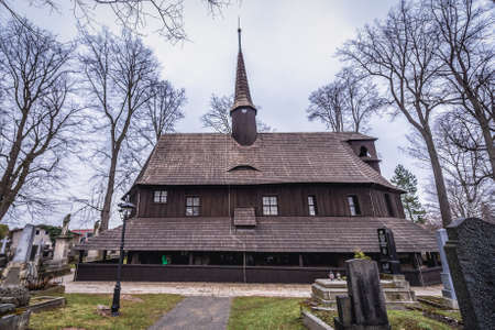 Broumov, Czech Republic - March 24, 2019: Historic wooden Church of Virgin Mary on a cemetery in Broumov city