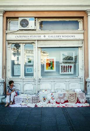 Belgrade, Serbia - August 29, 2015. Crochet tablecloths for sale on Prince Michael Street in Belgrade city