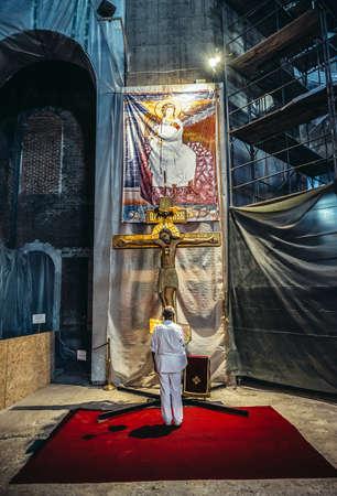 Belgrade, Serbia - August 29, 2015. Man stands in front of the cross in Saint Sava Church in Belgrade city