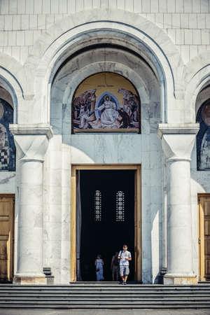 Belgrade, Serbia - August 29, 2015. Peopl walks through main entrance of Saint Sava Church in Belgrade city