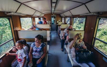 Serbia - August 28, 2015. Tourists travels old narrow gauge railway called Sargan Eight running from the village of Mokra Gora to Sargan Vitasi