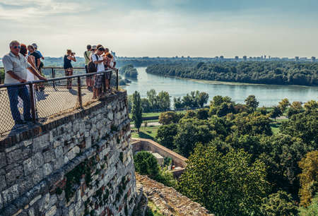 Belgrade, Serbia - August 29, 2015. Tourists looks at Danube River from walls of Upper City of Belgrade Fortress