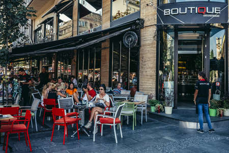 Belgrade, Serbia - August 29, 2015. People sits in Boutique restaurant located on the Square of the Republic