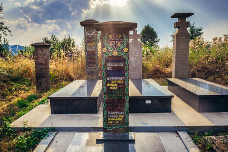 Lucani, Serbia - August 11, 2017: Tombstones on a traditional cemetery near Guca town in Serbia