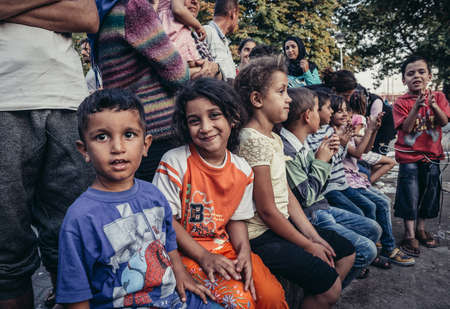 Belgrade, Serbia - August 29, 2015. Children in a makeshift refugee camp in one of the parks in Belgrade