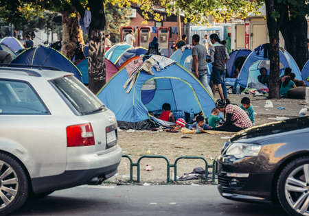 Belgrade, Serbia - August 29, 2015. People in a makeshift refugee camp in one of the parks in Belgrade