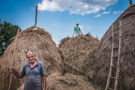 Lucani, Serbia - August 11, 2017: Farmers poses for photo in small settlement near Guca town in Lucani municipality