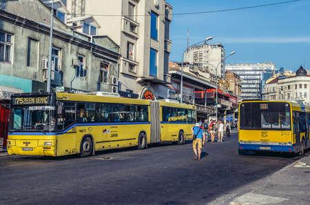 Belgrade, Serbia - August 29, 2015. Yellow buses on the street Bus in Zeleni Venac district