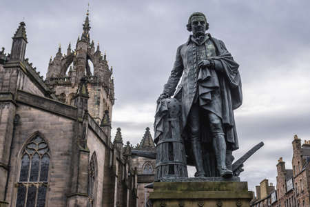 Monument to the Adam Smith in front of Saint Giles cathedral in the Old Town of Edinburgh city, Scotland, UK