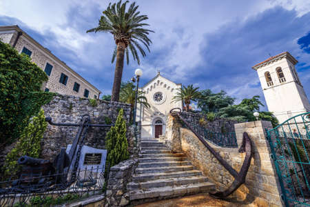 Herceg Novi, Montenegro - May 24, 2017: St Jerome church and large anchor monument located on one of the squares of historic part of Herceg Novi