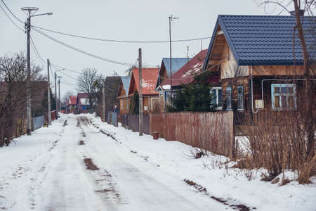 Road with traditional wooden folk cottages in Soce, small village in Podlasie region of Poland