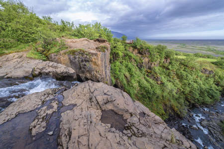 The top of Hundafoss waterfall in National Park Skaftafell protected area in Iceland