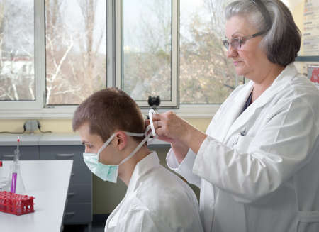 teacher and student in the laboratory photo