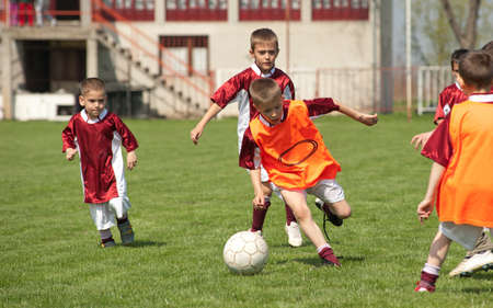 kids  soccer: children playing soccer on the sports field