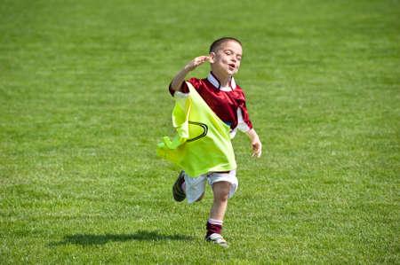 happy boy on the soccer field photo