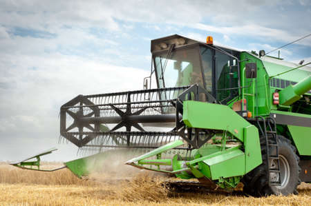 combine harvester: A combine harvester working in a wheat field