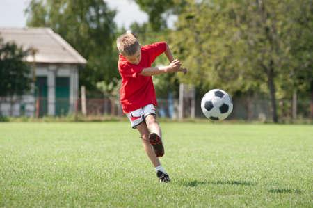 Little Boy Shooting at Goal Stock Photo