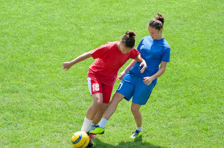 teens playing: Two young girls playing soccer Stock Photo