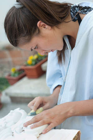 meticulous: young women engaged in manual work Stock Photo