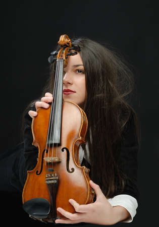 stringed: Pretty girl with violin isolated on black
