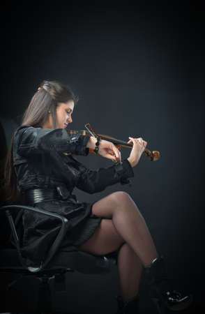 Young woman playing classic acoustic violin photo