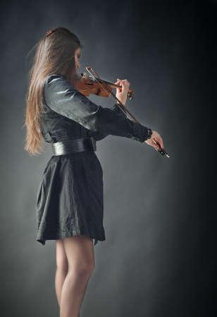 girl playing violin photo