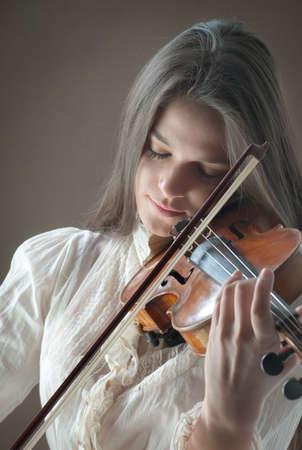 Pretty girl with violin photo
