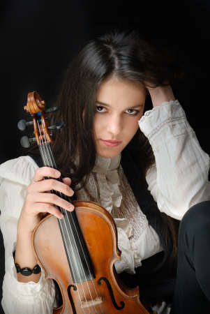 Pretty girl with violin isolated on black