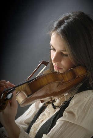 Pretty girl with violin Stock Photo - 10723526