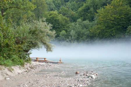 Fog over a river in early morning photo