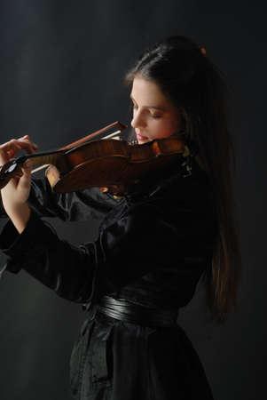 Pretty girl with violin Stock Photo - 10795524