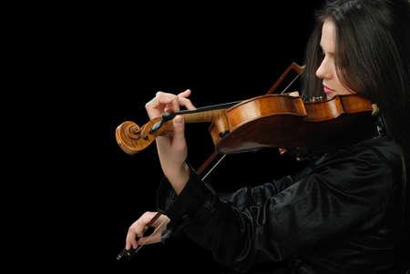violist: Mooi meisje met viool geïsoleerd op zwart Stockfoto