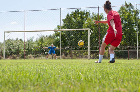 women playing soccer: Two young women playing soccer Editorial