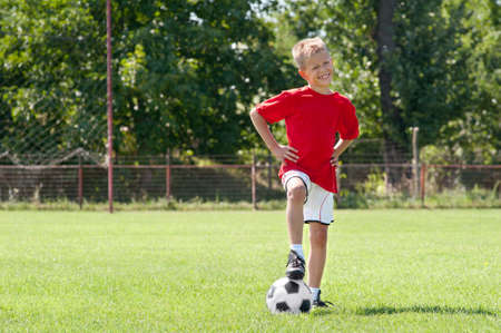 soccer kid posing on the soccer field Stock Photo - 10820484