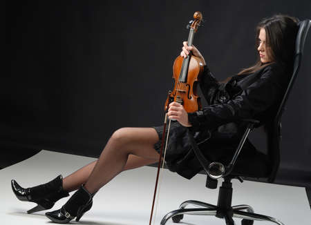 solo violinist: the girl with the violin is resting Stock Photo