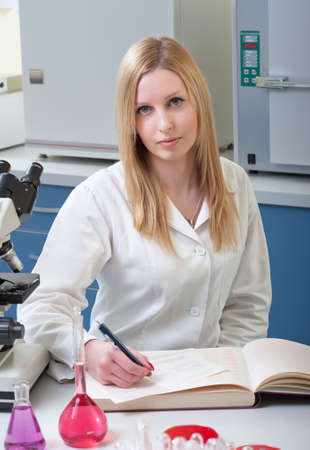 young medical student, writes in the laboratory photo