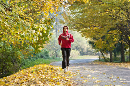 individual sports: Young man jogging in park
