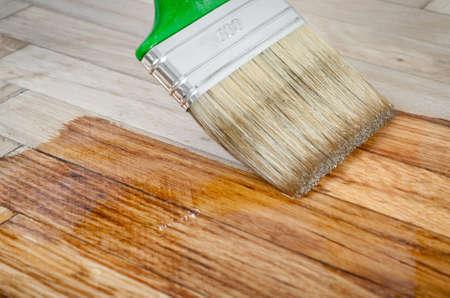 shiny floor: Varnish brush strokes on a wooden floor Stock Photo