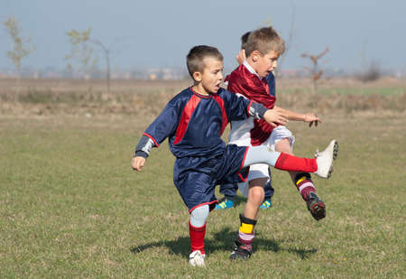 boy kicking football on the sports field Stock Photo - 11268869