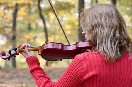 studious: Pretty girl playing the violin