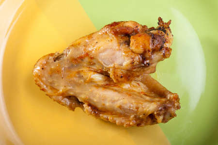 fresh roasted chicken wing on a plate photo