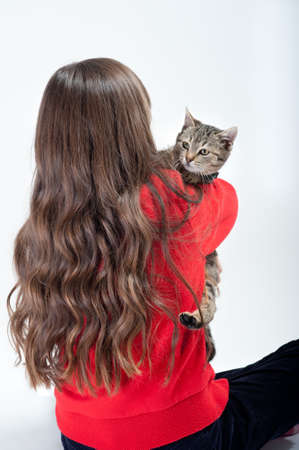 girls with long hair playing with cat Stock Photo - 11455513