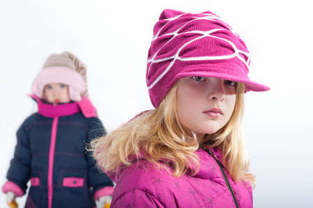 portrait of little girl in winter clothes photo