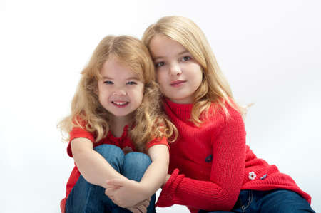two beautiful little girls on a white background photo