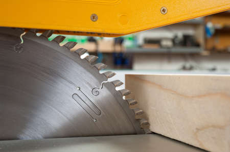 saws:  Circular saw cutting wooden plank Stock Photo